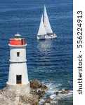 Sailing Boat With Lighthouse
