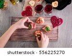 bruschetta. woman is cooking... | Shutterstock . vector #556225270