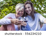 mother and adult daughter... | Shutterstock . vector #556234210