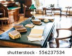vintage books and a lamp on the ...   Shutterstock . vector #556237534