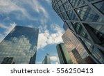 skyscrapers with glass facade.... | Shutterstock . vector #556250413