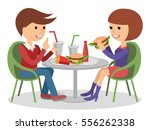 girl and boy eating fast food.... | Shutterstock .eps vector #556262338