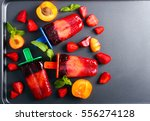 berry and fruit ice cream pops... | Shutterstock . vector #556274128