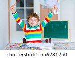 portrait of cute happy school... | Shutterstock . vector #556281250