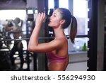 young muscular woman drinking...   Shutterstock . vector #556294930