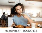 fashionable young man enjoying... | Shutterstock . vector #556302433