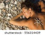 sunbathing and tan concept.... | Shutterstock . vector #556314439