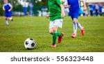 soccer football match. kids... | Shutterstock . vector #556323448