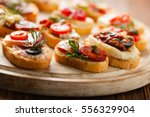 crostini with different... | Shutterstock . vector #556329904
