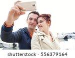 beautiful tourist couple using...   Shutterstock . vector #556379164