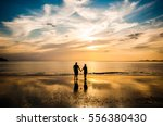 couple in love see sunset at... | Shutterstock . vector #556380430