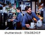 bartender waiter with a kettle...   Shutterstock . vector #556382419