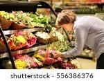 man buying flowers at a garden... | Shutterstock . vector #556386376