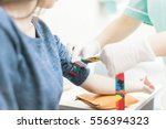 preparation for blood test | Shutterstock . vector #556394323