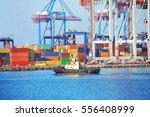 tugboat and crane in harbor...   Shutterstock . vector #556408999