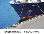 bulk carrier ship in port of... | Shutterstock . vector #556427998
