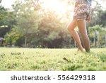 woman on sunset walking in... | Shutterstock . vector #556429318