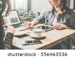 teamwork. two young business... | Shutterstock . vector #556463536