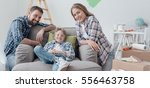 smiling young loving family... | Shutterstock . vector #556463758