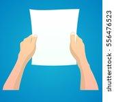 hands holding a blank sheet of... | Shutterstock .eps vector #556476523