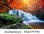 amazing waterfall in colorful... | Shutterstock . vector #556479790