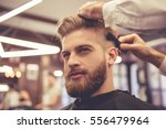 handsome bearded man is smiling ... | Shutterstock . vector #556479964