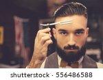 handsome bearded hairdresser in ... | Shutterstock . vector #556486588