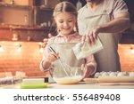 cute little girl and her... | Shutterstock . vector #556489408