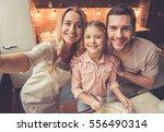 cute little girl and her... | Shutterstock . vector #556490314