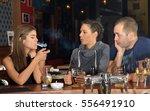 friends having drinks in a bar    Shutterstock . vector #556491910