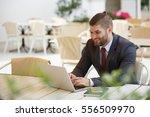 handsome businessman in suit... | Shutterstock . vector #556509970