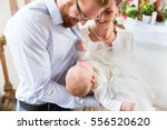 young parents at the church... | Shutterstock . vector #556520620