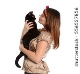 young woman holding and kissing ... | Shutterstock . vector #556527856