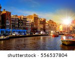 Stock photo traditional old buildings and and boats in amsterdam netherlands canals of amsterdam 556537804