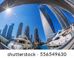 dubai marina with boats against ... | Shutterstock . vector #556549630