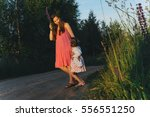happy girl in the country | Shutterstock . vector #556551250