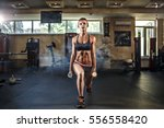 young sexy girl in the gym... | Shutterstock . vector #556558420