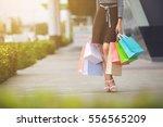 Woman Holding Many Shopping...