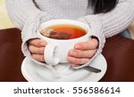 Stock photo woman drinking hot tea 556586614