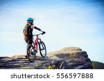 female mtb mountain biker... | Shutterstock . vector #556597888