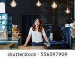 young female barista standing... | Shutterstock . vector #556597909
