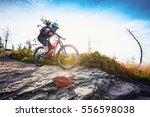 female mountain biker riding... | Shutterstock . vector #556598038