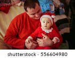 the father and son sitting on... | Shutterstock . vector #556604980