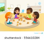 Children sit in circle on round carpet in kindergarten classroom, play with wooden toy blocks and laugh. Learning through entertainment concept. Vector illustration for flyer, website, poster, banner. | Shutterstock vector #556610284