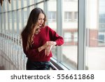 beautiful woman looks at the... | Shutterstock . vector #556611868