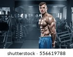 sexy muscular man in gym ... | Shutterstock . vector #556619788