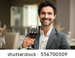 man tasting a glass of red wine ... | Shutterstock . vector #556700509