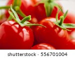 group of red fresh tomatoes... | Shutterstock . vector #556701004