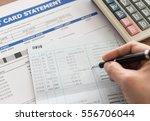 women checking amount in bank...   Shutterstock . vector #556706044