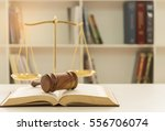 judges gavel on law books with... | Shutterstock . vector #556706074